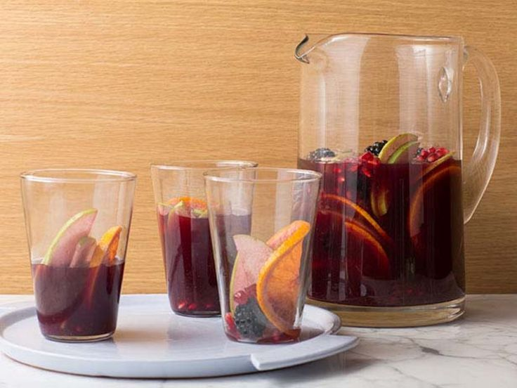 Red Wine Sangria : Red Spanish table wine is the base for this fruit-filled sangria. Mix in brandy, Triple Sec, orange juice and pomegranate juice with sliced fruits, then let it sit for the flavors to fully develop.