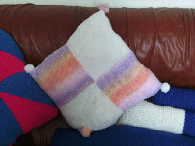 Pompom multicoloured cushion.