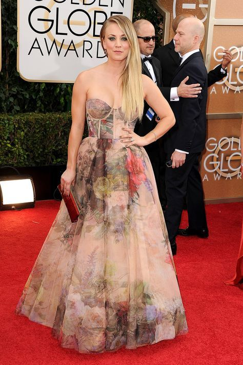 It's been a crazy few weeks for Kaley Cuoco — she married Ryan Sweeting in a romantic ceremony on New Year's Eve and was back in the spotlight for the People's Choice Awards last week. The actress returned to the red carpet at the Golden Globes tonight in a revealing dress.