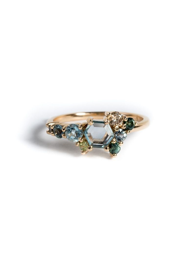 This a Personalization of our Hex Sapphire Cluster Ring in 14kt yellow gold.