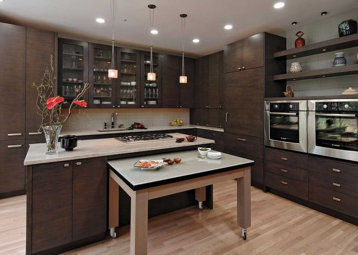 Kitchen with dark wood cabinets, light granite counters and a frosted
