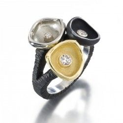 Sarah Graham 3 cup ring from the Confluence Collection, shown in 18k yellow and white gold, and oxidized colbalt chrome.
