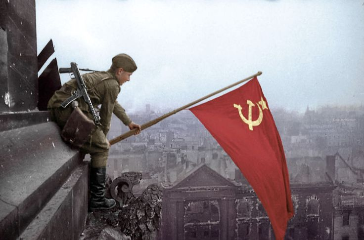 Soldier Waves A Soviet Flag, Berlin, 1945