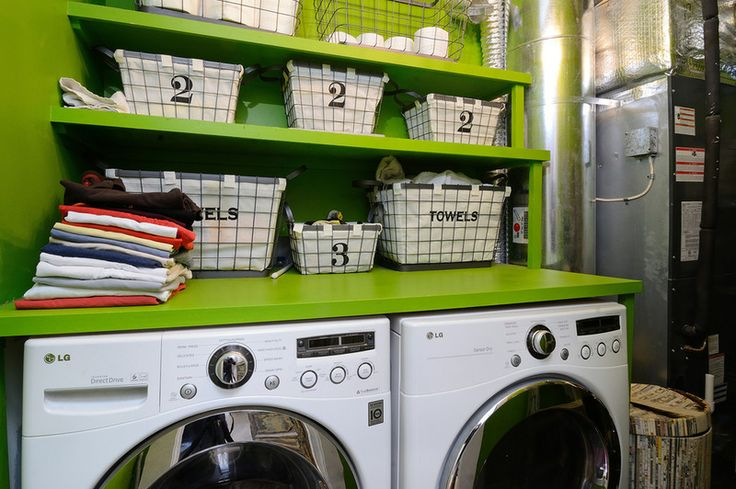 eclectic green & industrial laundry room |  Whistle while you work, knowing that your laundry area is as neat and clean as your freshly stacked clothes