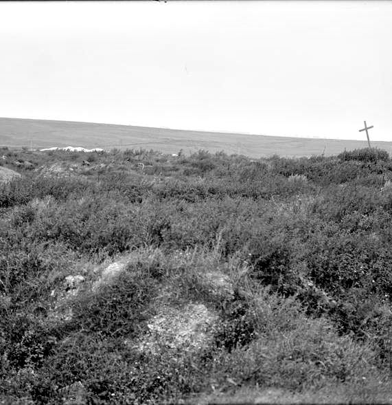 WWI, 2 Sept 1917; Site of the village of La Boisselle.  The white patch in the background is the chalk crater, (100 yards across and 90 deep), of the mine exploded by the British at the start of the Battle of the Somme on 1 July 1916. Cropped. © IWM (Q 2772)