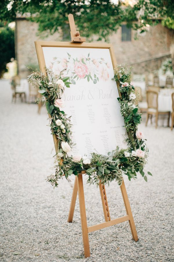 Rustic wooden framed escort card display: http://www.stylemepretty.com/destination-weddings/2017/01/12/saying-i-do-in-tuscany-never-disappoints/ Photography: M and J - http://www.mandjphotos.com/#photo-4454