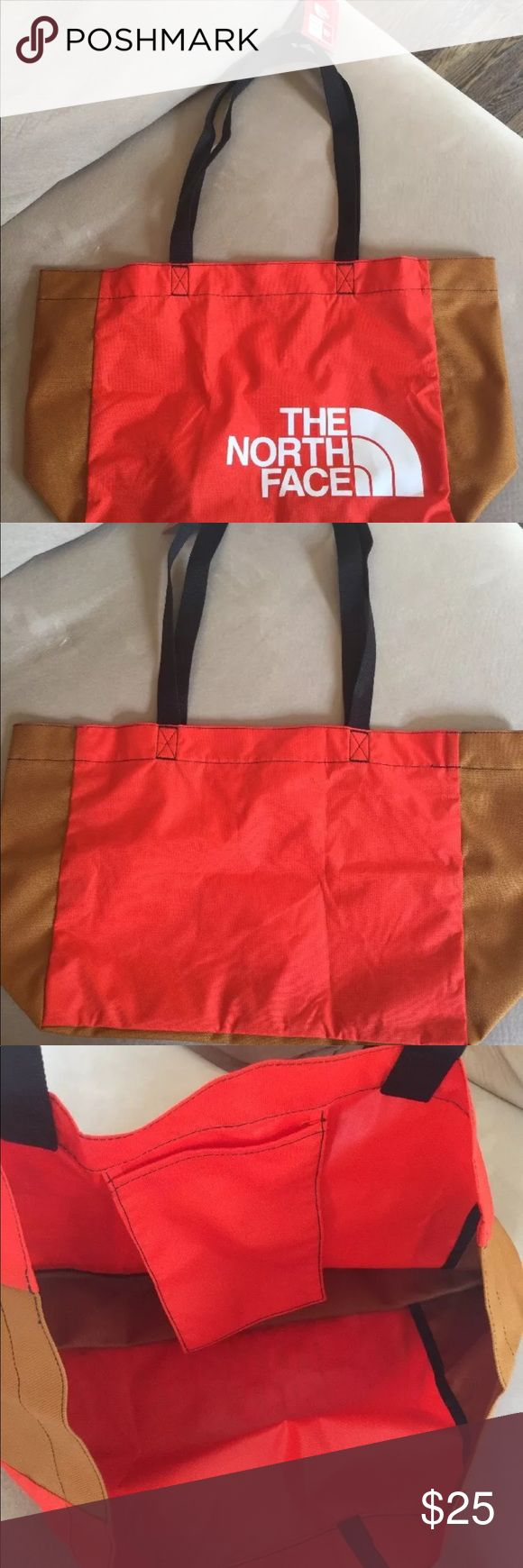 The North Face Large Tote Bag North Face Tote Bag nwt in excellent condition from a smoke free home. This bag came from an outlet store so it has no warranty. Extremely roomy. Color is a bright orange and brown. Make offer! The North Face Bags Totes