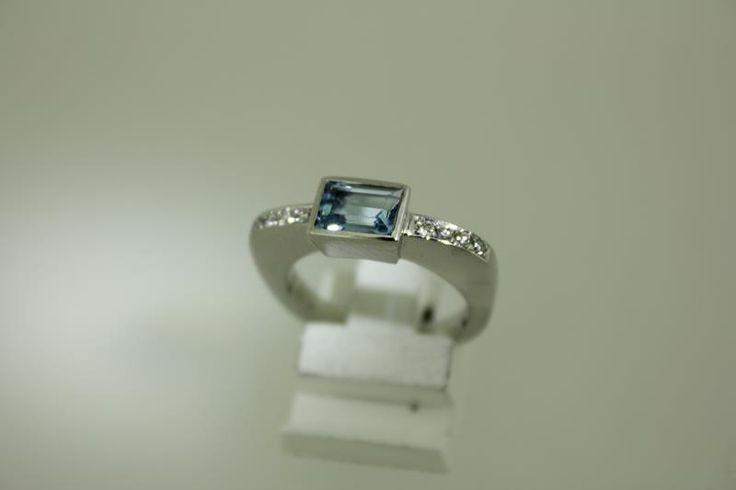 Beautiful 14 carat white gold ring with 8 (0.015ct) diamonds and an aquamarine.  Goldberg Juweliers http://www.goldbergjuweliers.nl/shop/products-page/briljanten/ring-14k-aquamarijn-en-briljant