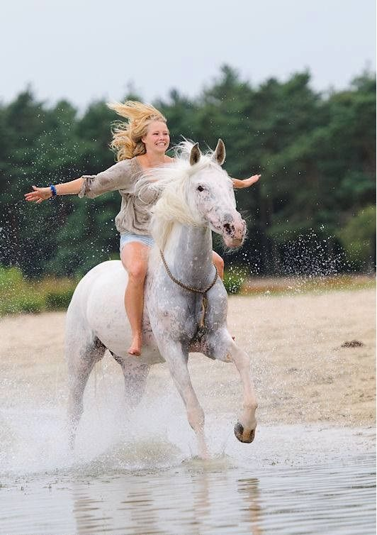 Flying on your horse at the beach, she looks happy :)