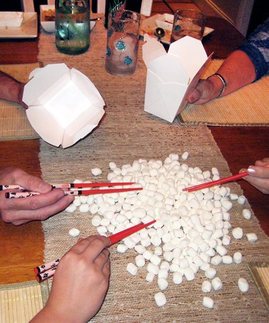 Christmas party games.  Christmas song pictionary/charades Marshmallow chopsticks (I would make challenging by having the person with the chopsticks use their non dominant hand, or stand behind a friend, teaching around then with the friend directing their moves