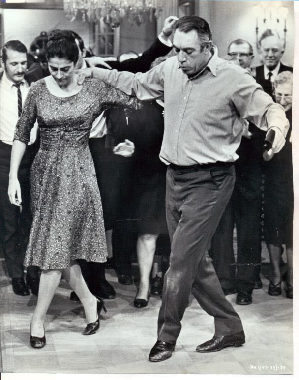 "Anthony Quinn and Irene Papas join in a traditional joyful Greek dance in a scene from film ""A dream of kings"" (1960)"