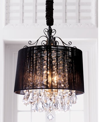 for an added interest, hang a shade over the chandelier