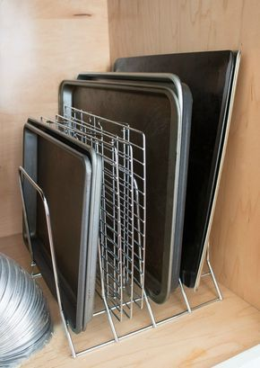 A simple metal rack keeps pans and cookie sheets neat and organized