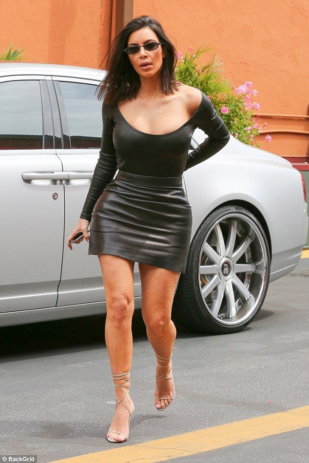 Sexy lady: Kim Kardashian showed off her chest and legs in this black outfit she wore to Chin Chin in the Studio City neighborhood of Los Angeles on Monday