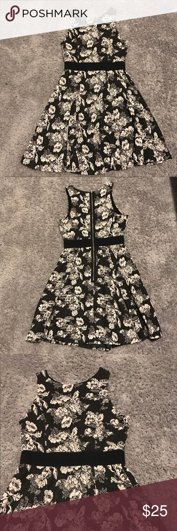 Black and Cream Floral Fit and Flare Dress Flora patterned dress with fitted waist band and flared skirt. Exposed back zipper. Thick and soft stretchy material. Brand is Bobeau (sold at Nordstrom). Size medium. bobeau Dresses