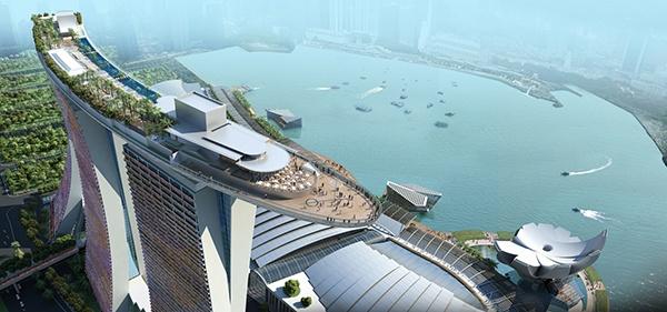 Отель «Marina Bay Sands» ***** (Сингапур).  На трех башнях высотой в 200 метров (55 этажей) располагается огромная терраса в виде гондолы с бассейнами и зелеными садами общей площадью 12,4 тыс. кв. метров. В отеле - 2500 номеров, торговый центр, конференц-зал, два театра, один музей, несколько ресторанов и казино!.  Стоимость размещения - от 380 USD за ночь.  Подробности: +7 495 9332333, sale@inna.ru   Будьте с нами! Открывайте мир с нами! Путешествуйте с нами!