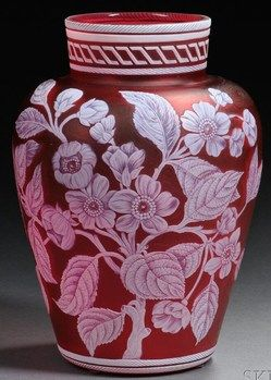 """Year: 1890 - 1920 A Thomas Webb & Sons Cameo glass vase, Stourbridge, England, late 19th to early 20th century, inverted baluster form with a squat collar decorated with incised white cameo bands, body with an apple blossom motif, a moth, and a maidenhair fern on a red ground, marked """"THOMAS WEBB & SONS/CAMEO"""" in a banner to underside."""