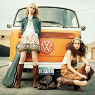 Hippies in front of a vw bus