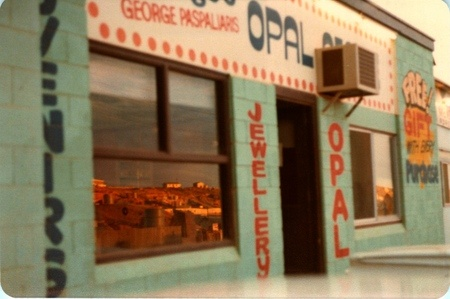 Opal Store, Coober Pedy, South Australia  Mines are reflected in the setting sun by the shop window