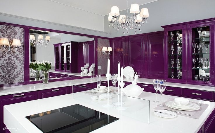Modern luxury kitchen, love the induction cooktop and glass draft break. Are cabinets purple or cherrywood?