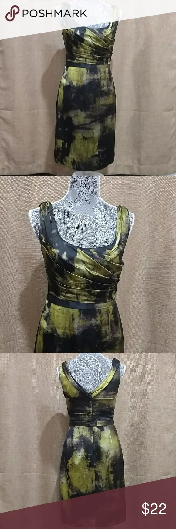 Gorgeous Elie Tahari Dress Worn once. Size 4. No flaws at all. I'm 5'6 tall and this falls right above my knee. Fully lined but very lightweight. Elie Tahari Dresses Asymmetrical