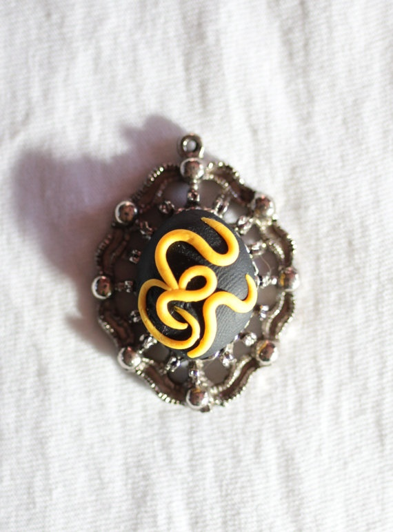 yellow on black fimo set in silver pendant. £4.