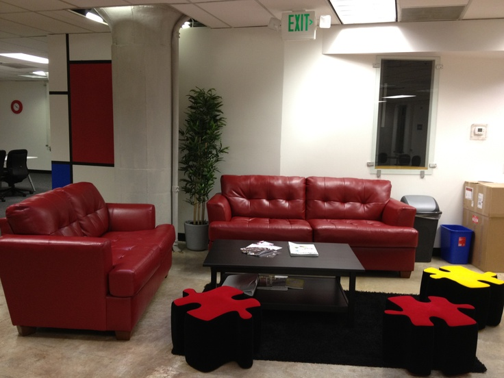 Our furniture had to tie into our new office concept, though we had to keep the budget in mind. A reasonably priced red sofa was tough to find, but it worked out in the end.