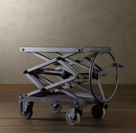 Adjustable-Height Metal Scissor-Lift Table.    A giant wheel shifts the top up n down via a durable set of out-of-the-way central mechanisms, allowing it to serve as coffee table, side table, bar cart or object stand at various heights. Great potential!