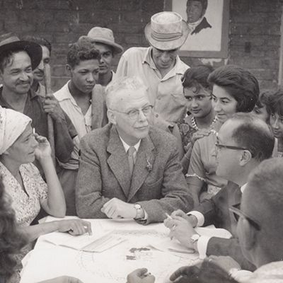 Dr. Richard Saunders (center) and Hector Abad Gomez (right) with residents of a neighborhood of Medellin, 1962
