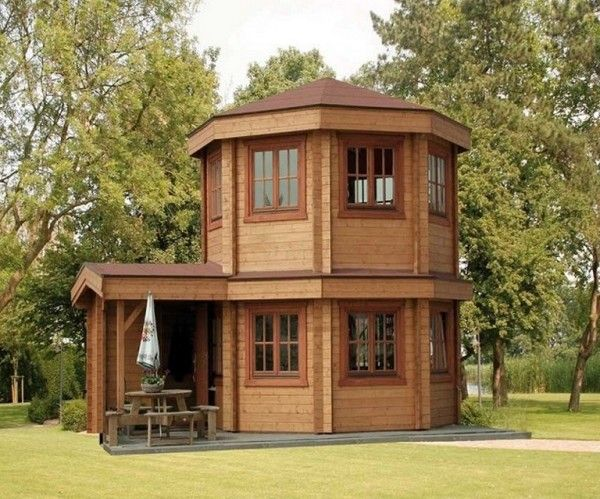 Pavilion Tiny House 001-1-It's a 16′ prefabricated log cabin with a dome shape. It also has an enclosed entryway. Read more at http://tinyhousetalk.com/the-toulouse-pavilion-tiny-house/#565EP3Up8TxOVdRg.99