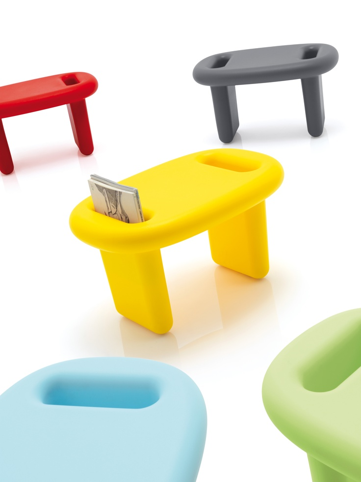SNOOP; triple identity: stool, low table, magazine rack, and also bookcase module, in rotomoulded polyethylene, design by Karim Rashid in 2011.