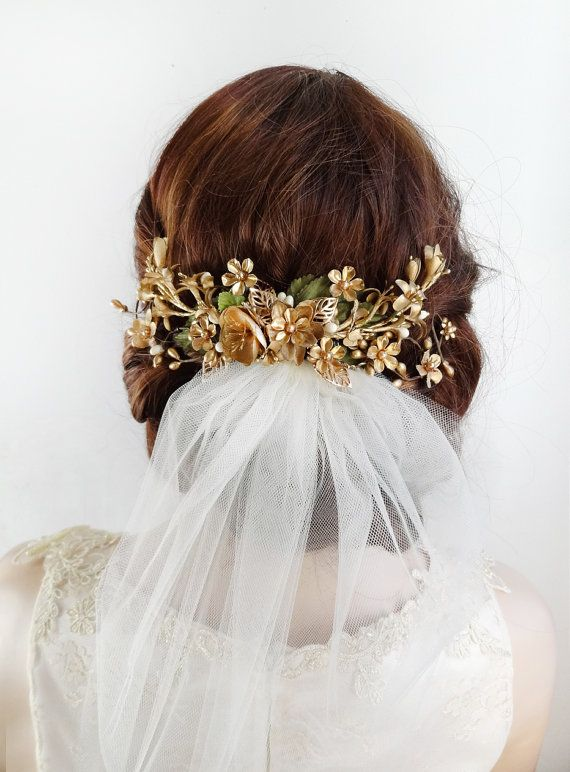 **Listing is for flower piece only. Veil not included.  A spectacular floral spray to wear above your bridal veil, or curving along your head above one ear.  Made from a mix of silk (metallic colored) flowers, and hand-wired metal flowers and leaves. Swarovski pearls are scattered throughout, and mossy green silk leaves peek up behind the center of the spray.  Size is about 8 across. Attaches on a metal alligator clip; looks best when further enforced on each end with a single bobby pin…