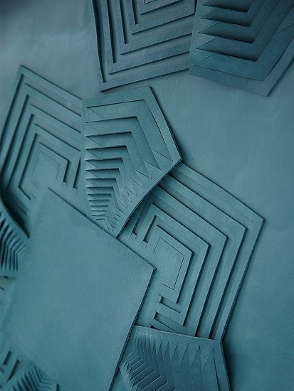 """""""A decorative leather wall panel made from hand cut and sculpted leather with a geometric motif inspired by Art Deco textiles and glassware."""" from Bespoke Global"""