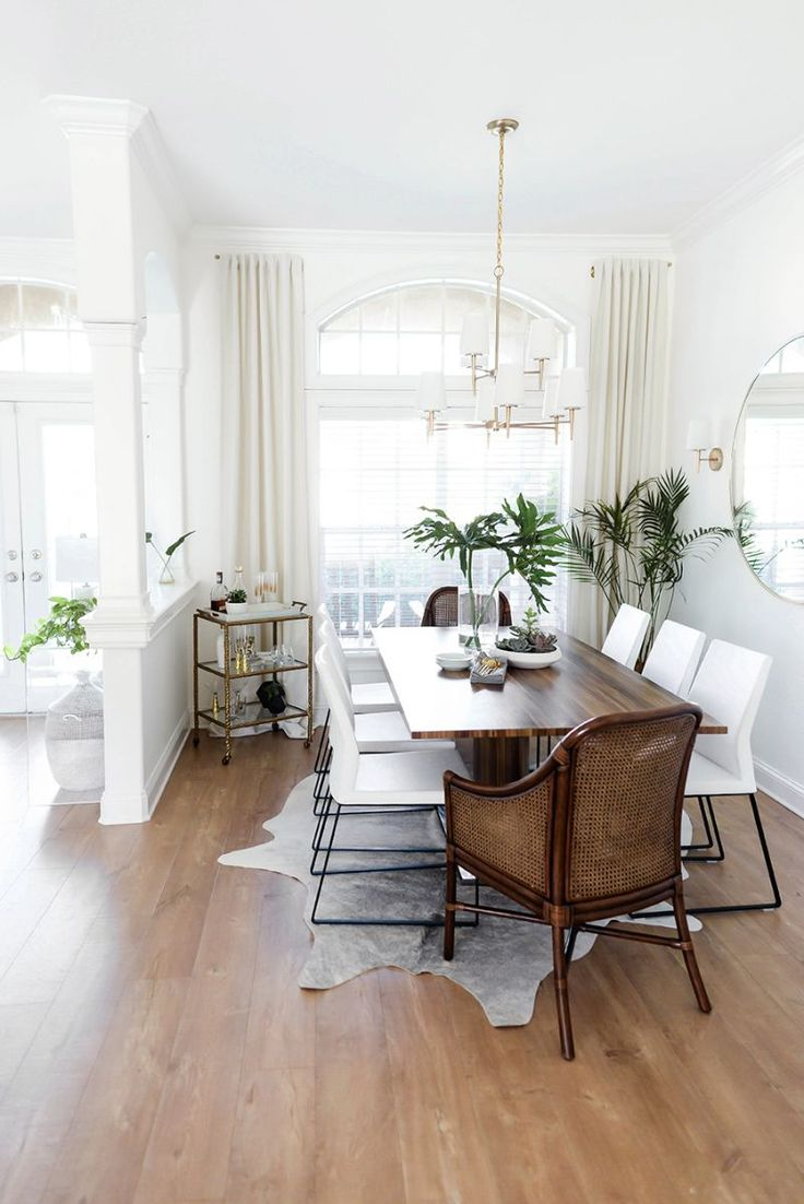 Ignore decor. Like the light & neutral tones of walls & floors & visual interest of windows