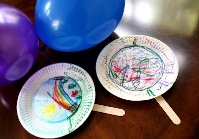 "After decorating paper plates and attaching paint stir sticks to make the rackets, play ""Balloon Badminton"" for some great indoor fun!"