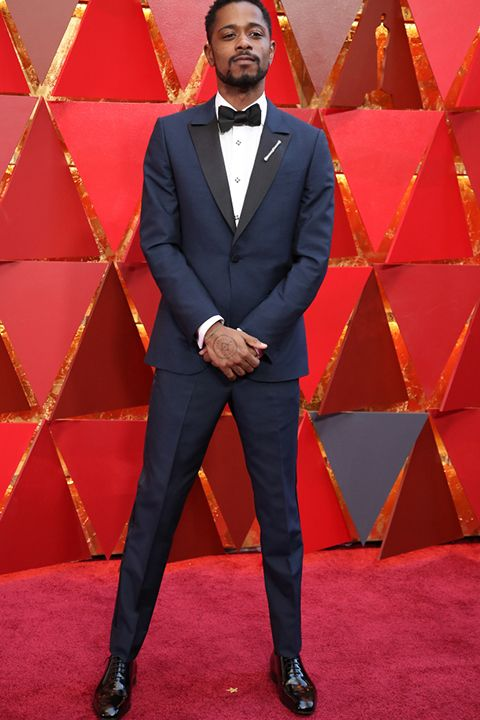 2018 academy awards lakeith stanfield navy blue tuxedo with black peak  lapels and white dress shirt with a black bow tie 1de1b96b528a