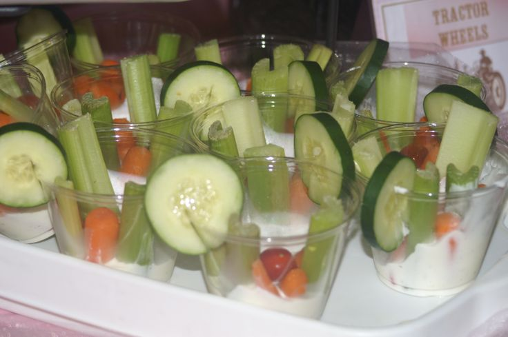 Veggies and dip in a cup!  Ranch at bottom of cup..topped with Carrots, celery, and a tiny tomato...and a cucumber on the top side of the cup