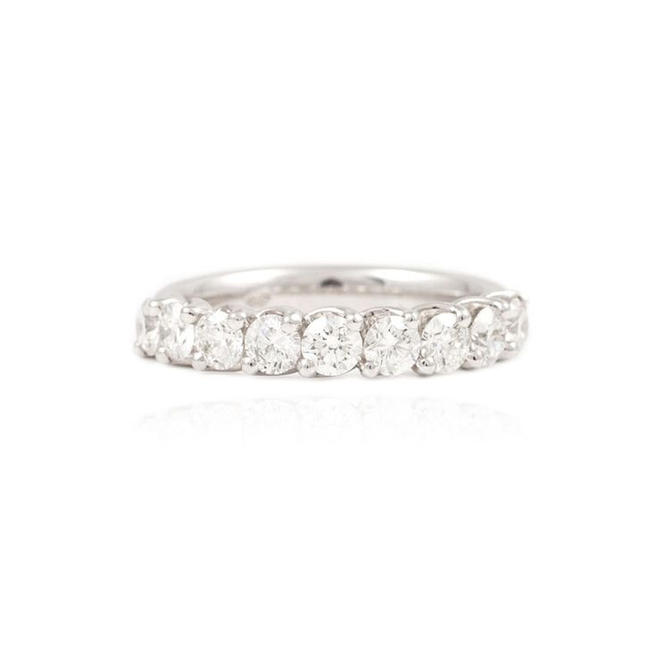 Nine stone twist set eternity ring set with round-brilliant cut diamonds in a platinum band. Discover the Paul Sheeran eternity ring collection.
