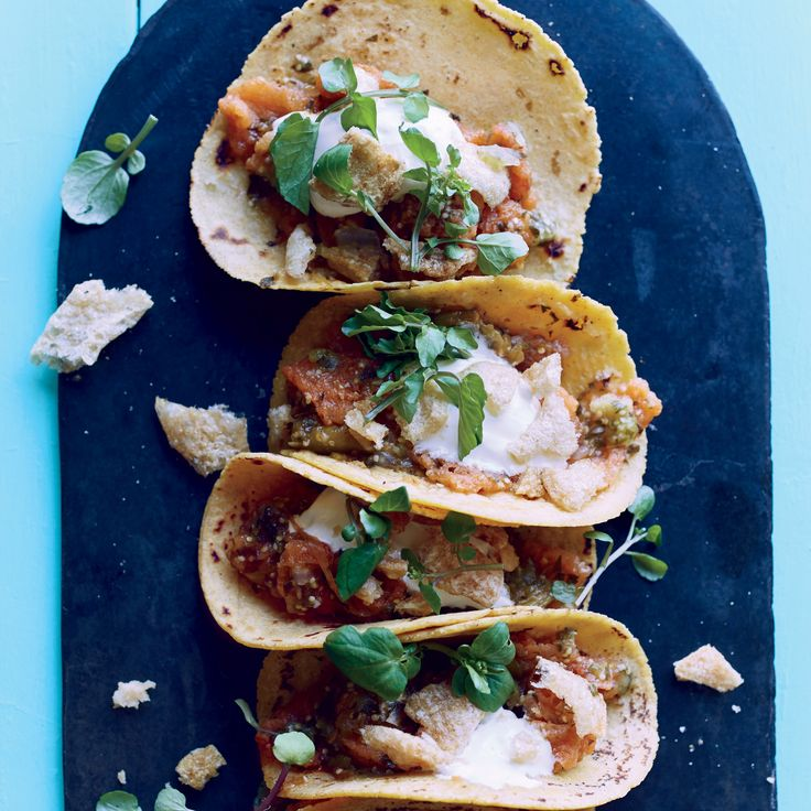 Get the recipe for these simple tacos, stuffed with fried pork rinds and salsa verde - yum!