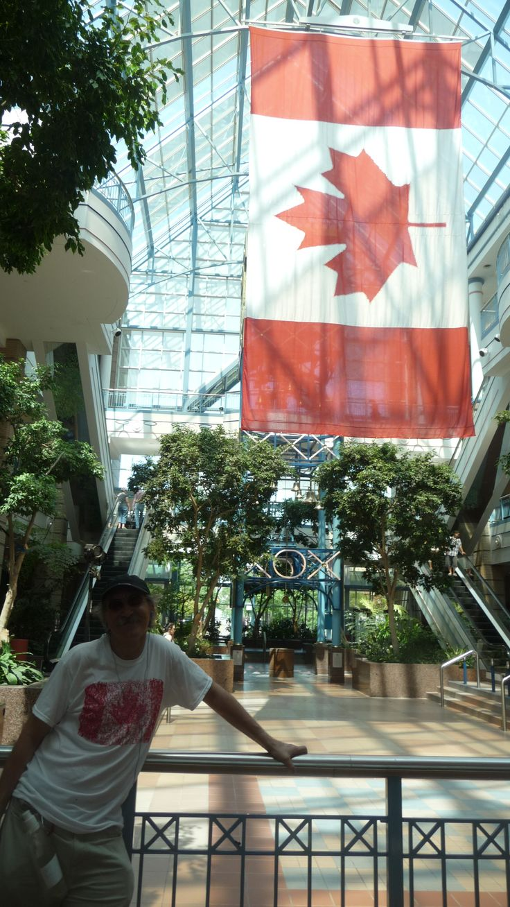 Barry posing in front of Large Canadian flag at Portage Place mall taken by nice Filipino gal