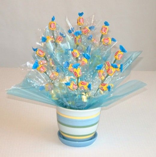 all kinds of edible arrangements - candy, fruit, etc - with diy instructions