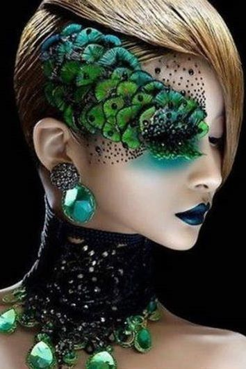 A peacock or fish look can be achieved with feathers or large pieces to look like scales. Curious to how this would look all over the face