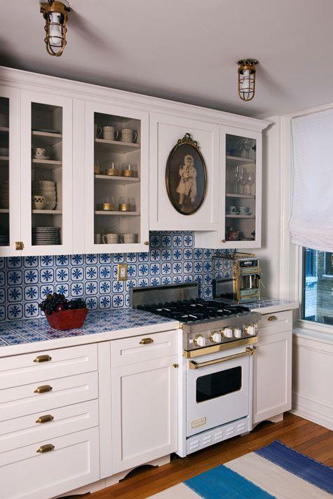 Lauren Stern via Design Sponge | white cabinets + blue patterned tiles