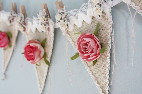 Burlap bunting, edged in ric-rac and lace - decorated with pink flowers -   such a CUTE idea!