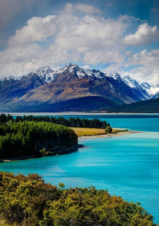 Lake Pukaki, New Zealand. Wow such a beautiful view of blue water green forests and high mountains all in one.