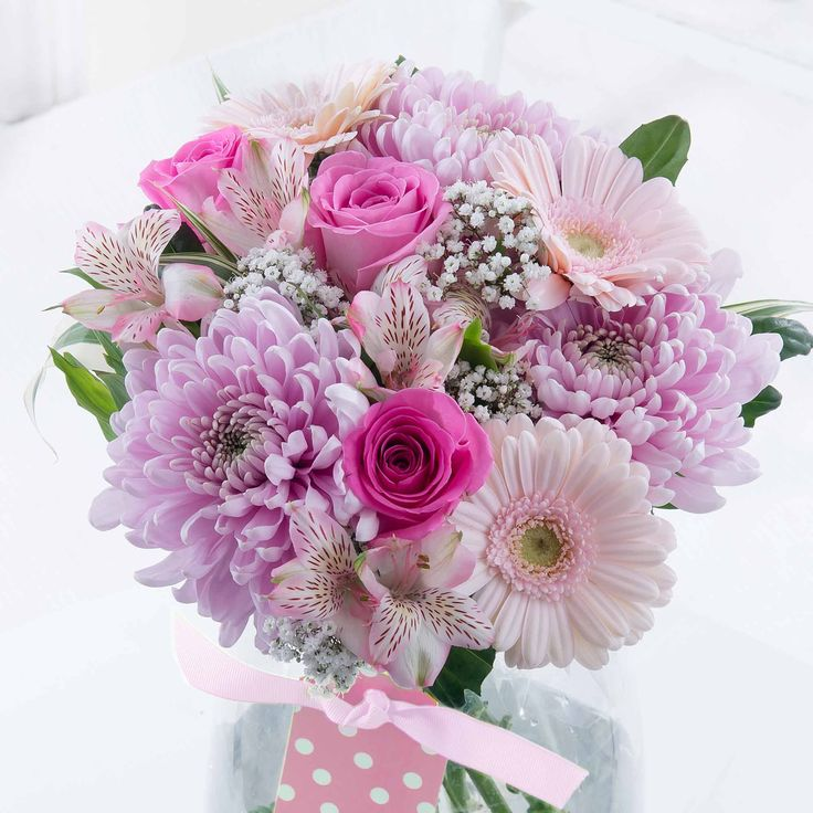 New Baby Girl Bouquet   Celebrate the new arrival with this beautiful bouquet in soft pink tones - a perfect way of welcoming a new baby girl into the world.