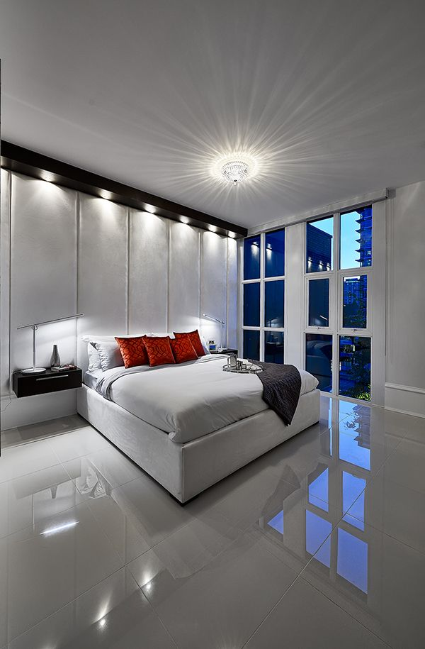 Expansive and unconventional bedroom spaces artistically engage all the senses, accentuated by floor to ceiling windows and glass encased walk-in closets. Artemisia by Boffo Developments Ltd.