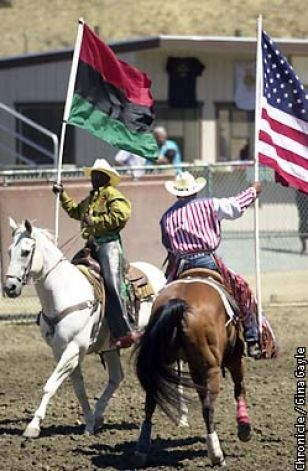 During the Grand Entry of the Bill Pickett Invitational Rodeo, the African flag and the American flag were brought into the stadium.•.♡.•
