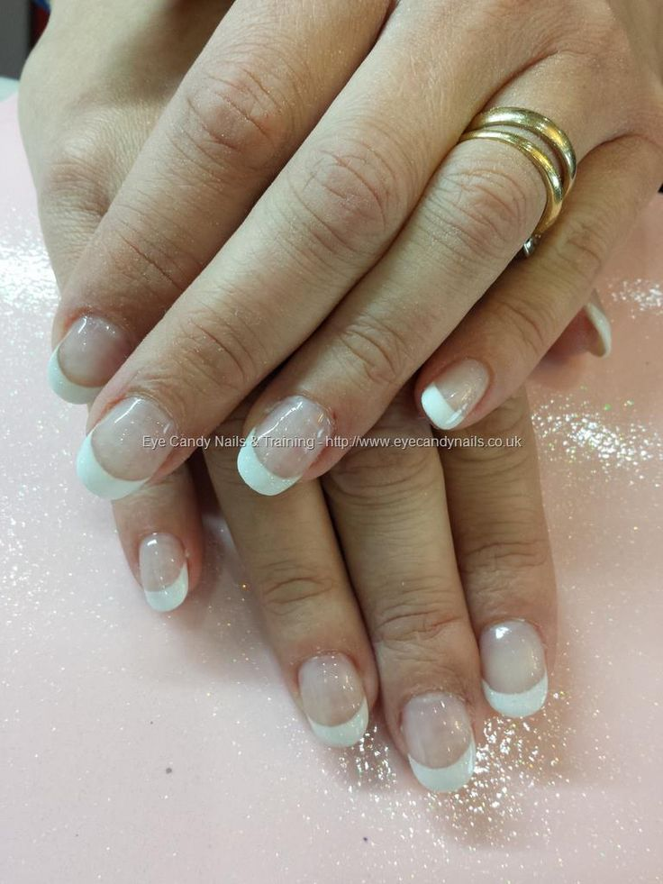 White acrylic tips and clear overlays