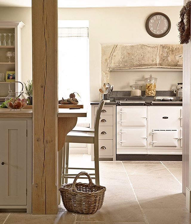Designer Emma Sims Hilditch hit upon the idea of transforming a vast drawing room into an open-plan kitchen-dining room in this Wilshire home. To create a lovely visual sense of warmth and depth in the room, which is complete with a bespoke larder, the cabinets were painted in a selection of subtle shades of grey. #kitchen #interior Photograph David Cleveland